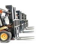 Four forklift trucks Stock Photos