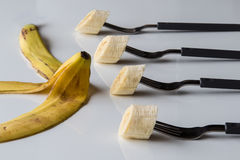 Four forks with banana Royalty Free Stock Photo