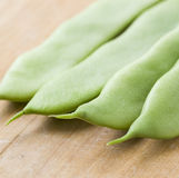 Four french beans. Some french beans macro detail in square composition Stock Images