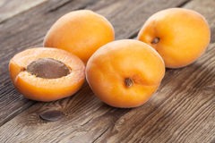 Four fresh apricots on old wood Royalty Free Stock Photography