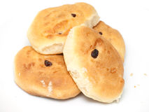 Four fresh buns with raisins. Four fresh homemade buns with raisins Royalty Free Stock Photography