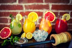Four fresh lemonades with fruits and ingredients Royalty Free Stock Photography