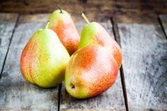 Four fresh organic ripe pears Stock Images