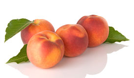 Four Fresh Peaches With Leaves Stock Photos