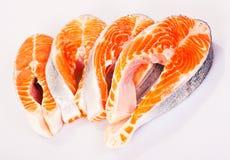 Four raw salmon steaks. Four fresh raw salmon steaks are laying Royalty Free Stock Photos
