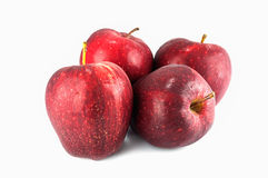 Four fresh red apples with drops isolated on white Royalty Free Stock Photo
