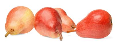 Four fresh red pears isolated on white. Bright saturated colors. Side view stock photo