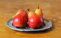 Four fresh red pears with water drops Royalty Free Stock Photo