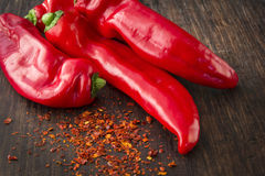 Four fresh red sweet (paprika) peppers Royalty Free Stock Image