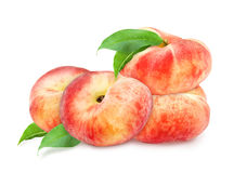 Four fresh ripe peaches with leaf. Stock Photo