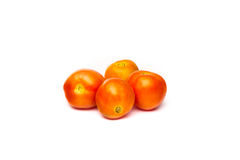 Four fresh tomatoes. Image of fresh tomatoes on a white background Royalty Free Stock Photography