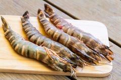 Four fresh whole tiger prawns Stock Photo