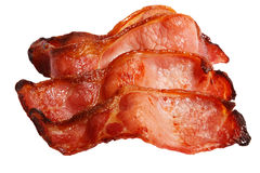 Four fried bacon rashers over white Royalty Free Stock Photography