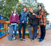 Four friend in skatepark Royalty Free Stock Images