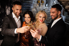 Four friends celebrating Royalty Free Stock Image
