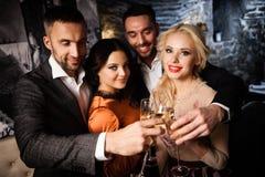 Four friends celebrating Stock Photo