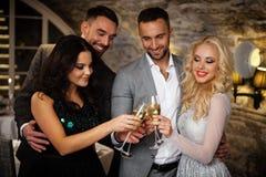 Four friends celebrating Stock Image