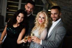 Four friends celebrating Royalty Free Stock Photo