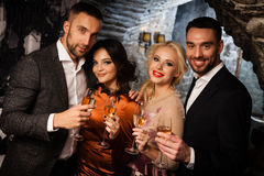 Four friends celebrating Stock Photos