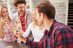 Four friends celebrating at home Royalty Free Stock Photo