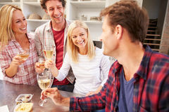 Four friends celebrating at home Stock Images