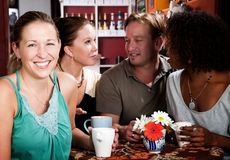Four Friends in a Coffee House Royalty Free Stock Photo
