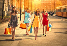 Four friends doing shopping Stock Photography