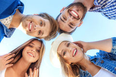 Four friends fooling around outdoors royalty free stock photography