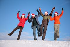 Four friends jump in santa cla Royalty Free Stock Photography
