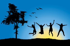 Four friends jumping on field near tree. Blue sky Stock Image