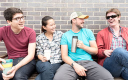 Four Friends Laughing Stock Images
