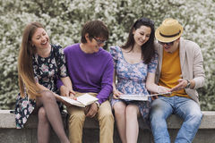 Four friends in the Park with books Royalty Free Stock Images
