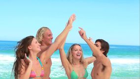 Four friends party at the beach together Stock Images