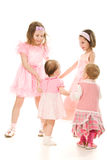 Four friends in a pink dress plays Royalty Free Stock Photography