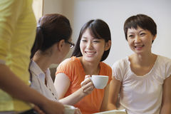 Four Friends sitting and talking in a coffee shop, Beijing Royalty Free Stock Photo