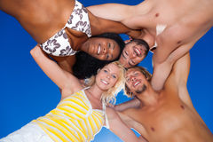 Four friends in vacation at the beach Stock Photo