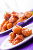 Four fritters in a small plate. Royalty Free Stock Photos