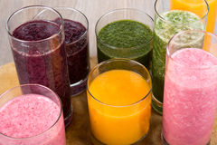 Four fruit, berry and vegetables healthy smoothies Stock Photos