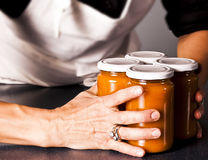 Four fruit jars in a woman´s hand Royalty Free Stock Images