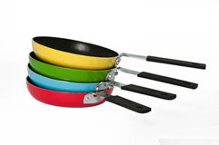 Four frying pans on a white background Royalty Free Stock Photos