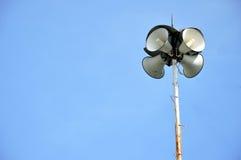 Four funnel loudspeakers. Against blue sky Stock Photo