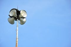 Four funnel loudspeakers. Against blue sky Royalty Free Stock Photography