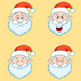 Four funny Santa Claus heads - set. Stock Photos