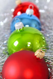 Four fur-tree toys in a tinsel. Removed close up Stock Photo