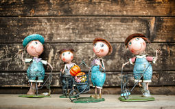 Four garden figurines. Figurines farmers on the wood Royalty Free Stock Image