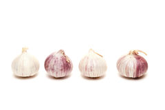 Four garlics Royalty Free Stock Photography