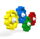 Four Gears Working Together. Four colorful gears working together in unity Stock Photo