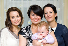 Four generation portrait. Four women portrait representing four generations in a family royalty free stock image