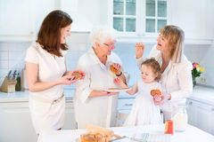 Four generations of women baking apple pie stock photography