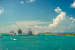 Four giant cruise ships in a row at Nassau port with a lot of yachts foreground. Bahamas.  Royalty Free Stock Photos